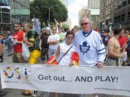 Brian Burke with the OutSport Toronto team just before the parade starts.